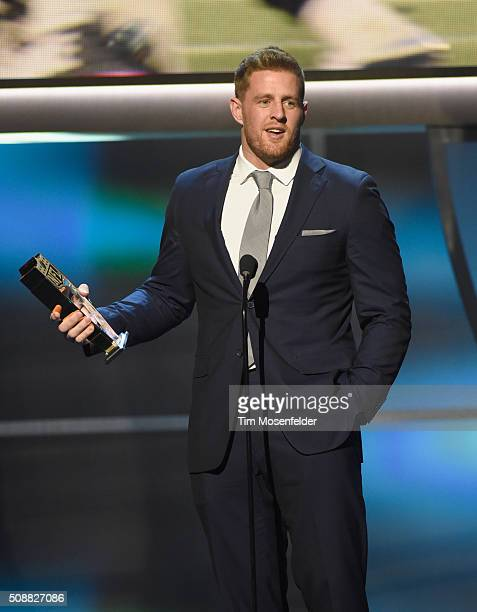 NFL player J J Watt accepts the AP Defensive Player of the Year award onstage during the 5th Annual NFL Honors at Bill Graham Civic Auditorium on...