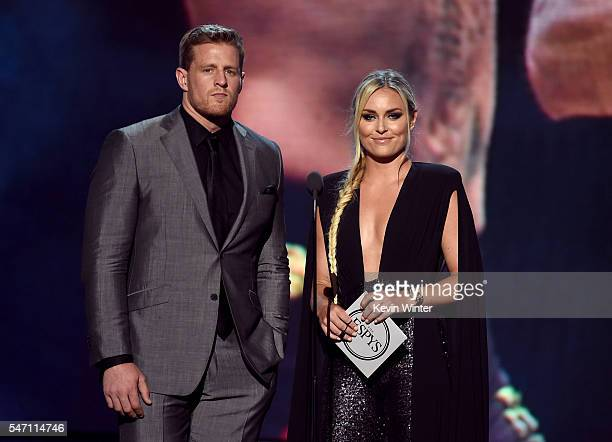 NFL player J J Watt and alpine ski racer Lindsey Vonn speak onstage during the 2016 ESPYS at Microsoft Theater on July 13 2016 in Los Angeles...