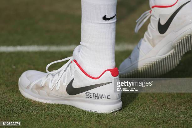 US player Jack Sock plays with a tribute to injured US player Bethanie MattekSands written on his shoes on the fifth day of the 2017 Wimbledon...