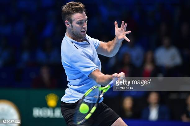 US player Jack Sock returns to Germany's Alexander Zverev during their men's singles roundrobin match on day five of the ATP World Tour Finals tennis...