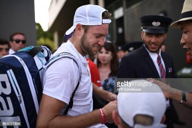 US player Jack Sock signs autographs after winning his men's singles first round match against China's Christian Garin on the second day of the 2017...