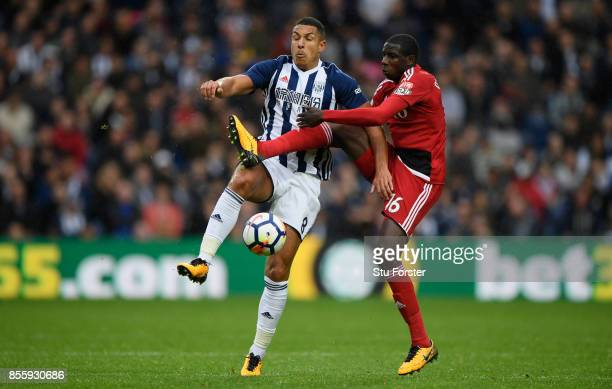 WBA player Jake Livermore is challenged by Abdoulaye Doucoure of Watford during the Premier League match between West Bromwich Albion and Watford at...