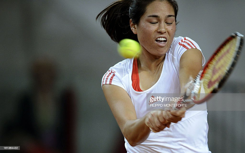 US player Jamie Hapton returns a ball to Italy's Roberta Vinci during their Fed Cup tennis match in Rimini's 105 Stadium on February 10, 2013.Vinci won 6-2, 4-6, 6-1. AFP PHOTO / FILIPPO MONTEFORTE