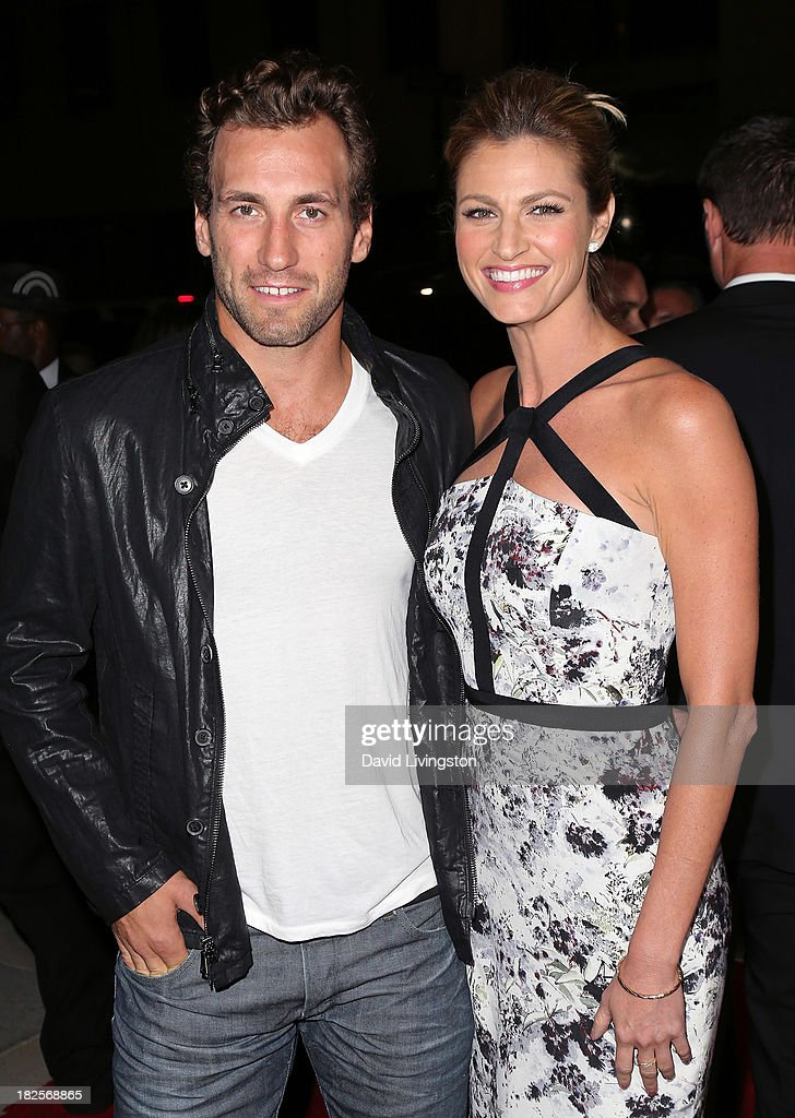 Player Jarret Stoll (L) and sportscaster Erin Andrews attend the premiere of Columbia Pictures' 'Captain Phillips' at the Academy of Motion Picture Arts and Sciences on September 30, 2013 in Beverly Hills, California.