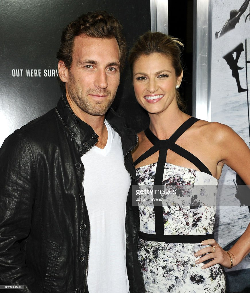 NHL player Jarret Stoll and sportscaster Erin Andrews attend the premiere of 'Captain Phillips' at the Academy of Motion Picture Arts and Sciences on September 30, 2013 in Beverly Hills, California.