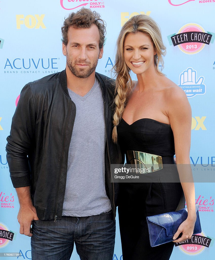 NHL player <a gi-track='captionPersonalityLinkClicked' href=/galleries/search?phrase=Jarret+Stoll&family=editorial&specificpeople=204632 ng-click='$event.stopPropagation()'>Jarret Stoll</a> and TV personality <a gi-track='captionPersonalityLinkClicked' href=/galleries/search?phrase=Erin+Andrews&family=editorial&specificpeople=834273 ng-click='$event.stopPropagation()'>Erin Andrews</a> arrive at the 2013 Teen Choice Awards at Gibson Amphitheatre on August 11, 2013 in Universal City, California.