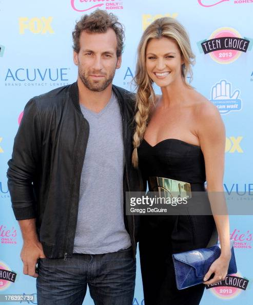 NHL player Jarret Stoll and TV personality Erin Andrews arrive at the 2013 Teen Choice Awards at Gibson Amphitheatre on August 11 2013 in Universal...