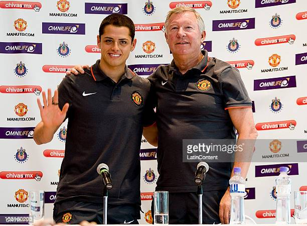 Player Javier Hernandez and head coach Alex Ferguson of Manchester United pose for photographers during a press conference one day before a friendly...