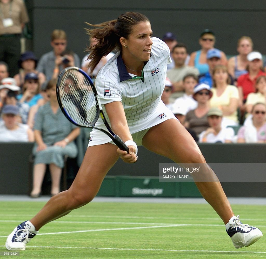 US player Jennifer Capriati plays a volley during her second round match against Italian Francesca Schiavone at the All England Tennis Championships...
