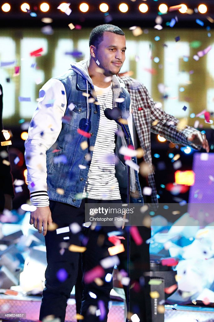 NFL player Jermaine Kearse of the Seattle Seahawks speaks onstage during Cartoon Network's fourth annual Hall of Game Awards at Barker Hangar on February 15, 2014 in Santa Monica, California.