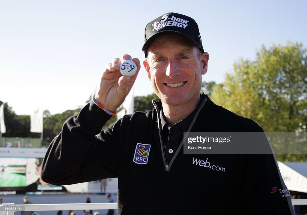 PGA TOUR player <a gi-track='captionPersonalityLinkClicked' href=/galleries/search?phrase=Jim+Furyk&family=editorial&specificpeople=202579 ng-click='$event.stopPropagation()'>Jim Furyk</a> poses with a 59 golf ball signifying his 12-under-par 59 during the second round of the 2013 BMW Championship at Conway Farms Golf Club on September 13, 2013 in Lake Forest, IL. Furyk became only the sixth player in PGA TOUR history to record a 59 during a competitive round.