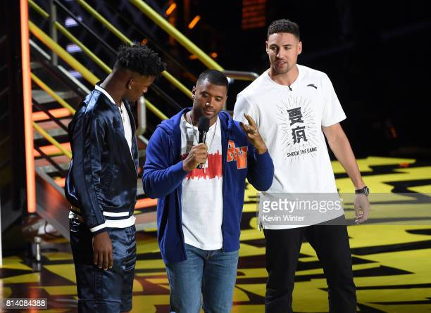 NBA player Jimmy Butler host Russell Wilson and NBA player Klay Thompson speak onstage during Nickelodeon Kids' Choice Sports Awards 2017 at Pauley...