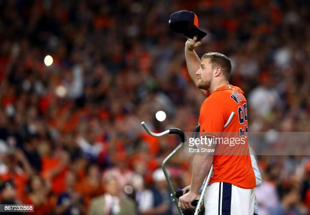 NFL player JJ Watt of the Houston Texans throws out the ceremonial first pitch before game three of the 2017 World Series between the Houston Astros...