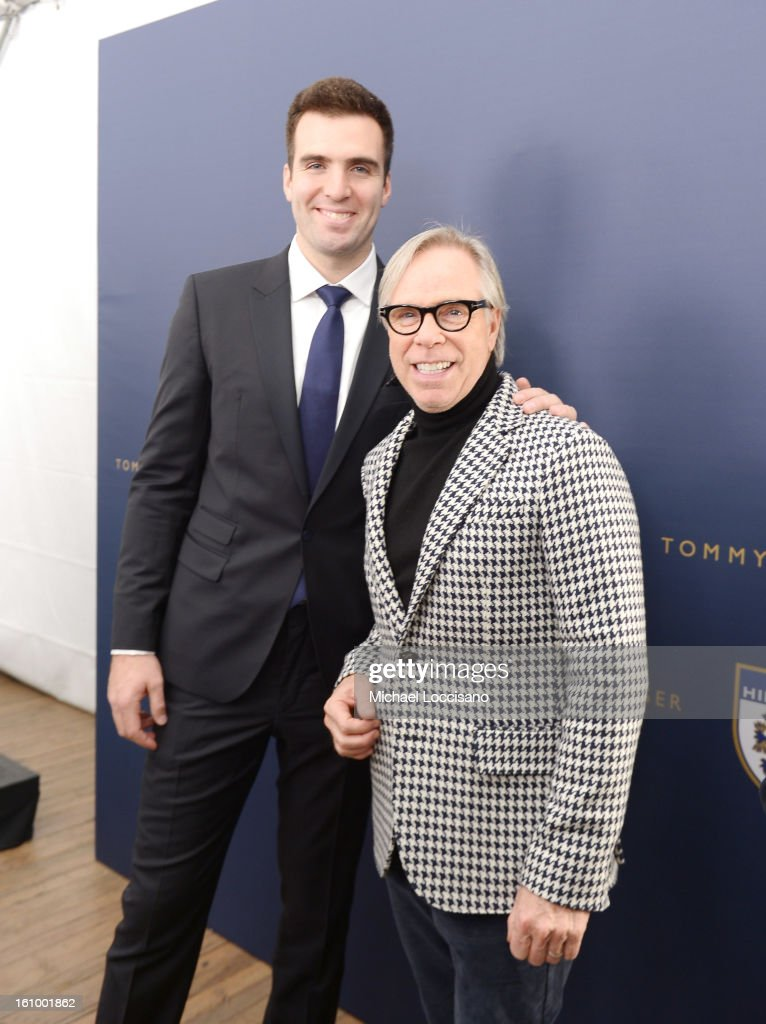 NFL player Joe Flacco (L) and designer Tommy Hilfiger pose backstage at the Tommy Hilfiger Men's Fall 2013 fashion show during Mercedes-Benz Fashion Week at Park Avenue Armory on February 8, 2013 in New York City.