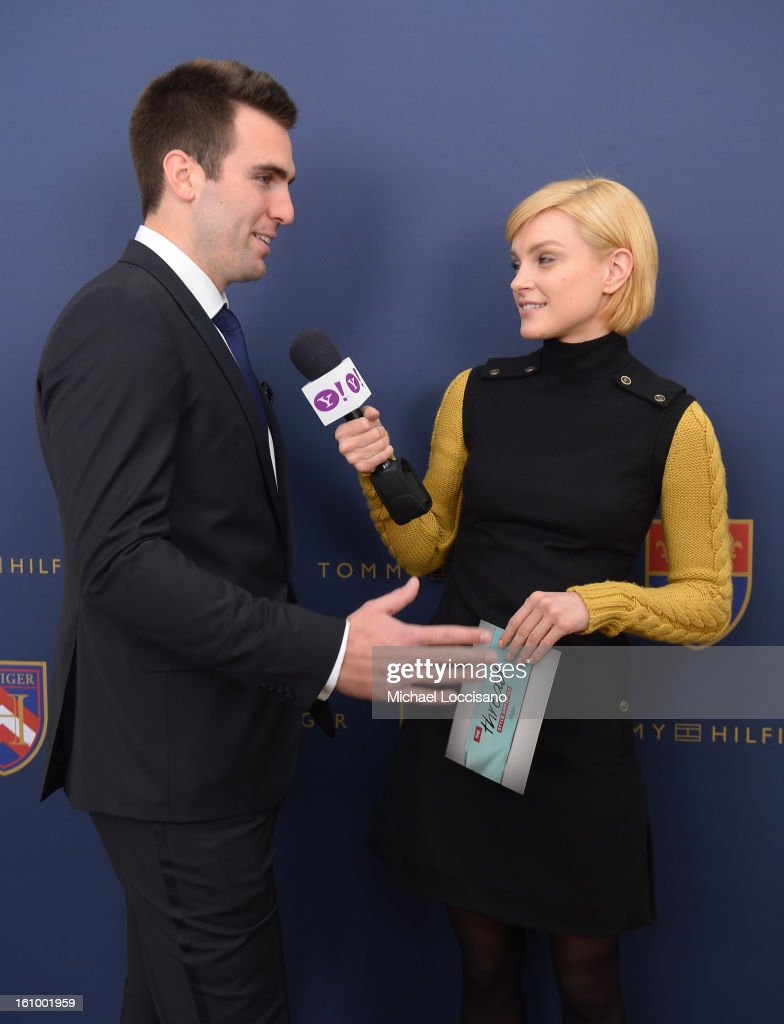 NFL player <a gi-track='captionPersonalityLinkClicked' href=/galleries/search?phrase=Joe+Flacco&family=editorial&specificpeople=4645672 ng-click='$event.stopPropagation()'>Joe Flacco</a> is interviewed backstage at the Tommy Hilfiger Men's Fall 2013 fashion show during Mercedes-Benz Fashion Week at Park Avenue Armory on February 8, 2013 in New York City.