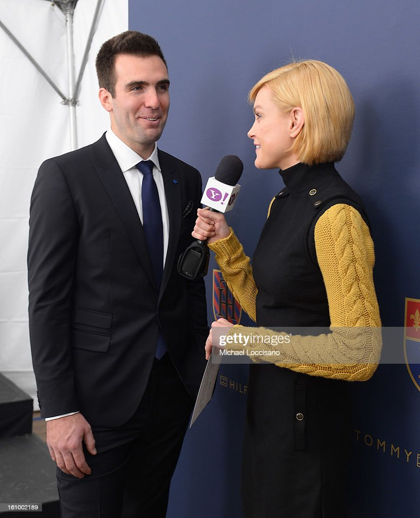 NFL player <a gi-track='captionPersonalityLinkClicked' href=/galleries/search?phrase=Joe+Flacco&family=editorial&specificpeople=4645672 ng-click='$event.stopPropagation()'>Joe Flacco</a> is interviewed backstage by Jessica Stamm at the Tommy Hilfiger Men's Fall 2013 fashion show during Mercedes-Benz Fashion Week at Park Avenue Armory on February 8, 2013 in New York City.