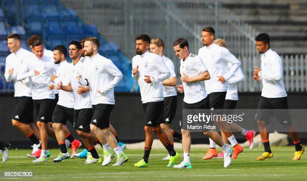 Player jog during a Germany training session/press conference ahead of their international friendly match against Denmark at Brondby Stadion on June...