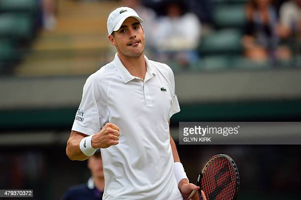 US player John Isner celebrates going 32 up in the fifth set against Croatia's Marin Cilic during their men's singles third round match on day five...