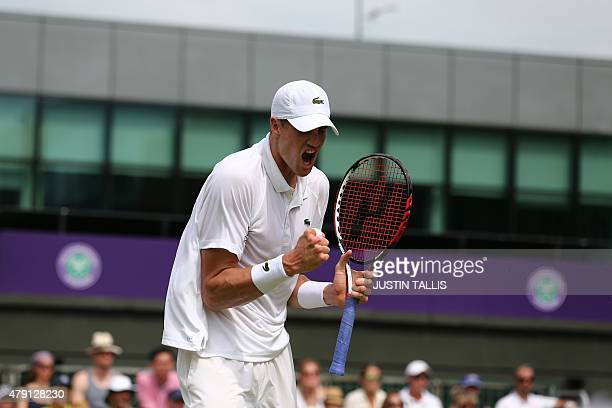US player John Isner celebrates winning the second set against Australia's Matthew Ebden during their men's singles second round match on day three...