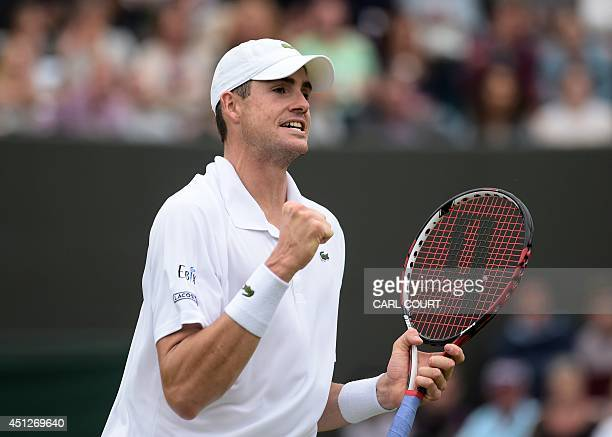 US player John Isner reacts winning his men's singles second round match against Finland's Jarkko Nieminen on day four of the 2014 Wimbledon...