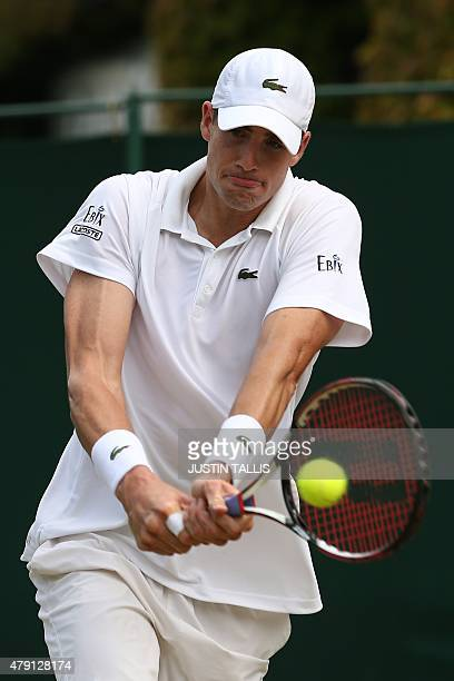 US player John Isner returns against Australia's Matthew Ebden during their men's singles second round match on day three of the 2015 Wimbledon...