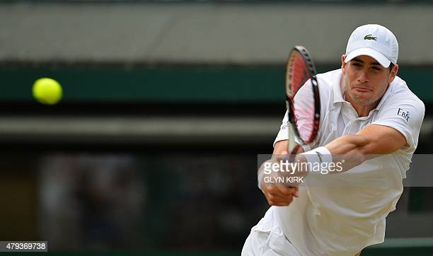 US player John Isner returns against Croatia's Marin Cilic during their men's singles third round match on day five of the 2015 Wimbledon...