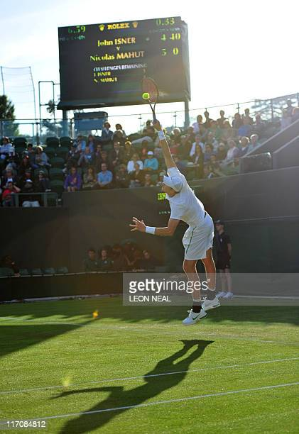 US player John Isner serves to French player Nicolas Mahut during the men's single at the Wimbledon Tennis Championships at the All England Tennis...