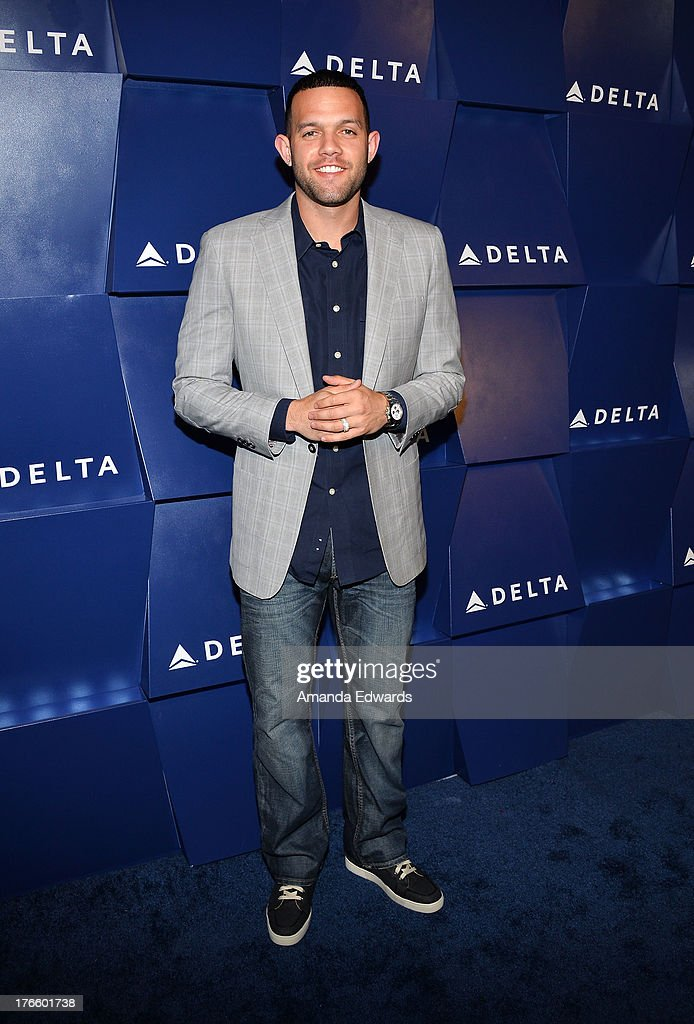 NBA player Jordan Farmar arrives at the Delta Air Lines Summer Celebration at Beverly Grove Drive on August 15, 2013 in Beverly Hills, California.