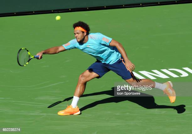 ATP player JoWilfried Tsonga makes a diving return during the third set of a match against Fabio Fognini played on March 11 2017 during the BNP...