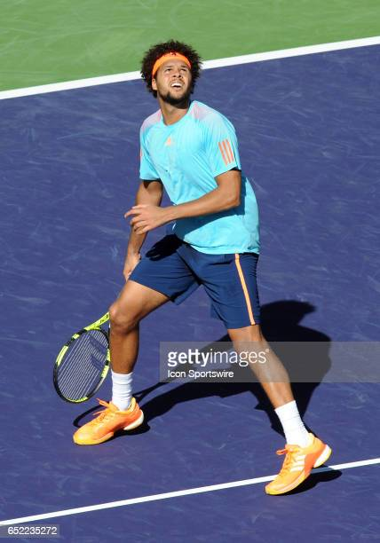 ATP player JoWilfried Tsonga moves backwards while looking up at the ball during the third set of a match against Fabio Fognini played on March 11...