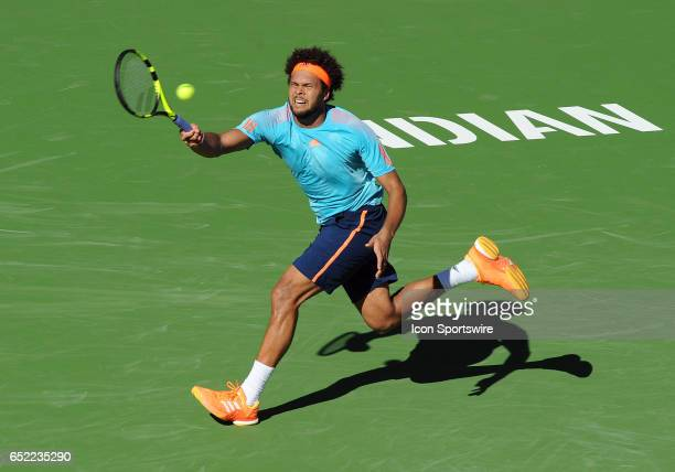ATP player JoWilfried Tsonga stretches to return a shoot during the third set of a match against Fabio Fognini played on March 11 2017 during the BNP...