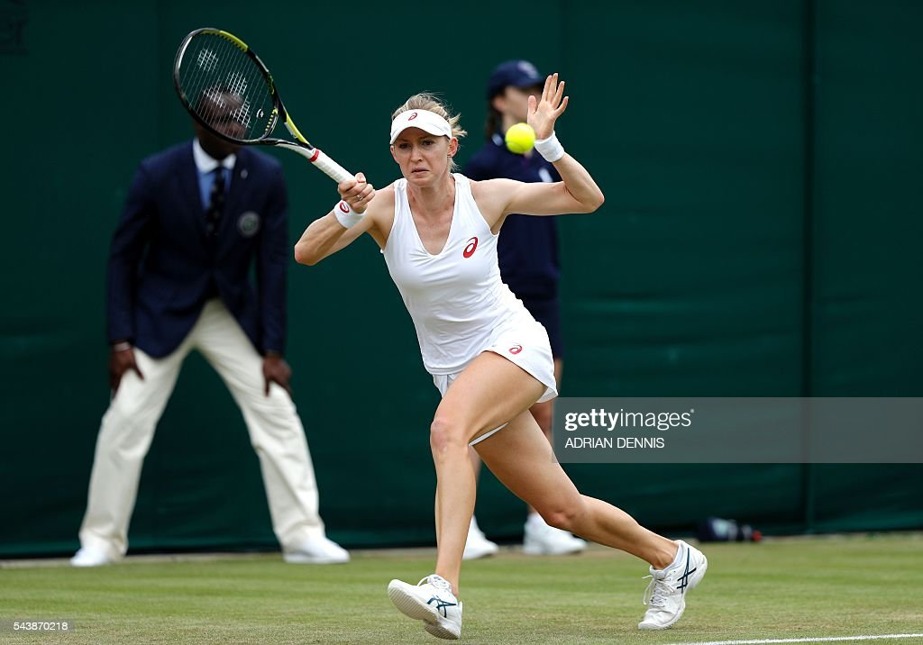 US player Julia Boserup returns to Switzerland's Belinda Bencic during their women's singles second round match on the fourth day of the 2016 Wimbledon Championships at The All England Lawn Tennis Club in Wimbledon, southwest London, on June 30, 2016. / AFP / ADRIAN