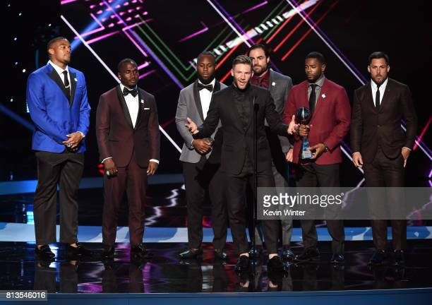 NFL player Julian Edelman and teammates accept the Best Game award for Super Bowl LI onstage at The 2017 ESPYS at Microsoft Theater on July 12 2017...