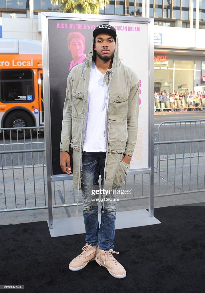NBA player KarlAnthony Towns arrives at the premiere of Warner Bros Pictures' 'War Dogs' at TCL Chinese Theatre on August 15 2016 in Hollywood...