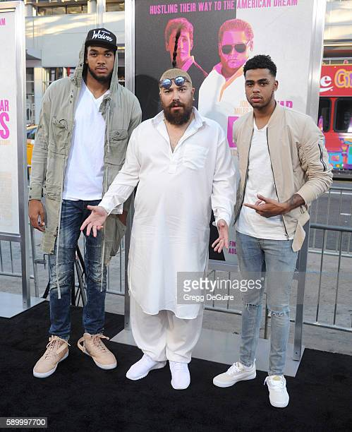 NBA player KarlAnthony Towns Josh 'The Fat Jew' Ostrovsky and NBA player D'Angelo Russell arrive at the premiere of Warner Bros Pictures' 'War Dogs'...