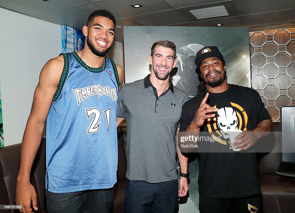 NBA player Karl-Anthony Towns, Olympic swimmer Michael Phelps and NFL player Marshawn Lynch attend The Ultimate Fan Experience, Call Of Duty XP 2016 presented by Activision at The Forum on September 2, 2016 in Inglewood, California.