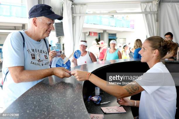 WTA player Karolina Pliskova of Czech Republic meets with fans and signs autographs during the Western Southern Open at the Lindner Family Tennis...