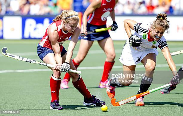 USA player Kathleen Sharkey and German player Marie Mavers compete during a stage match in the women's tournament of the Field Hockey World Cup in...