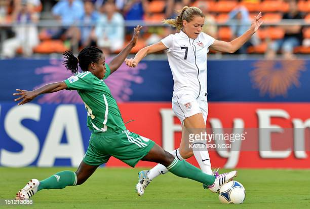 US player Kealia Ohai and Nigeria's Cecilia Nku fight for the ball during their under20 women's World Cup semifinal football match at the National...