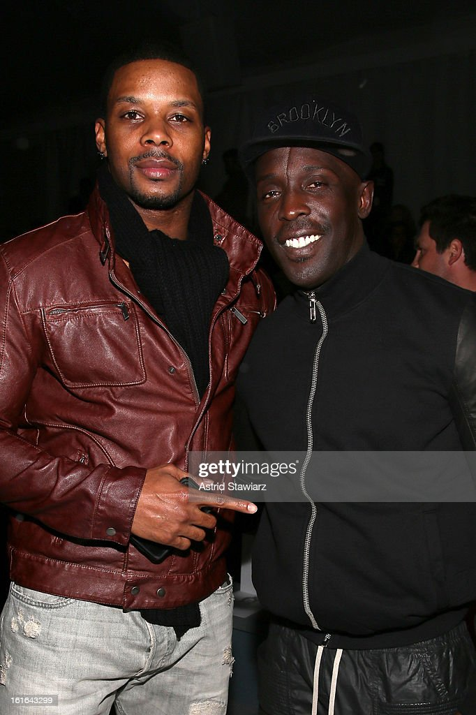 NFL player <a gi-track='captionPersonalityLinkClicked' href=/galleries/search?phrase=Kerry+Rhodes&family=editorial&specificpeople=567200 ng-click='$event.stopPropagation()'>Kerry Rhodes</a> and actor Michael Kenneth Williams attend the Zang Toi Fall 2013 fashion show during Mercedes-Benz Fashion Week at The Stage at Lincoln Center on February 13, 2013 in New York City.