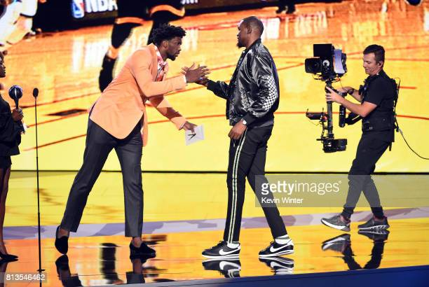 NBA player Kevin Durant accepts the Best Championship Performance award from NBA player Joel Embiid onstage at The 2017 ESPYS at Microsoft Theater on...
