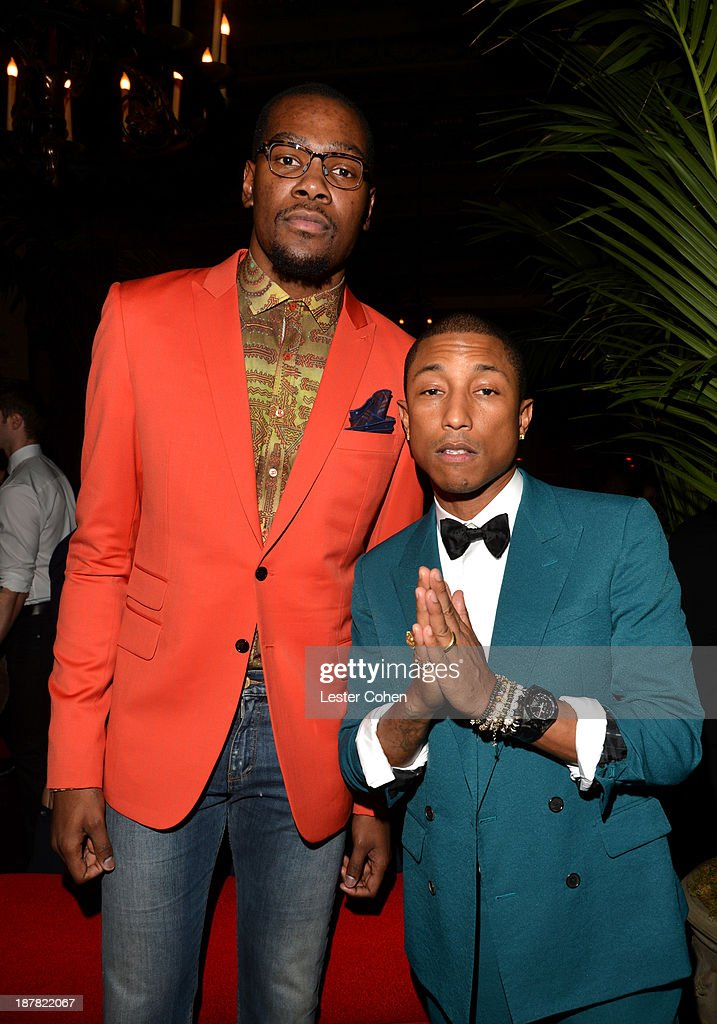 Player Kevin Durant and singer Pharrell Williams attend the GQ Men Of The Year Party at The Ebell Club of Los Angeles on November 12, 2013 in Los Angeles, California.