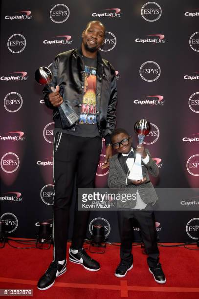 NBA player Kevin Durant winner of the Best Championship Performance award and Jarrius Robertson winner of the Award for Perseverance attend The 2017...