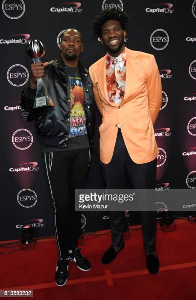 NBA player Kevin Durant winner of the Best Championship Performance award and NBA player Joel Embiid attend The 2017 ESPYS at Microsoft Theater on...