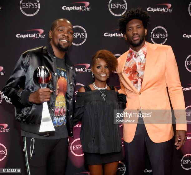 NBA player Kevin Durant winner of the Best Championship Performance award actor Issa Rae and NBA player Joel Embiid attend The 2017 ESPYS at...
