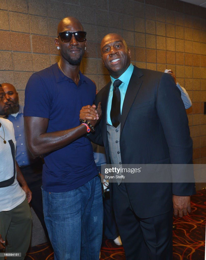 NBA player Kevin Garnett (L) and NBA Hall of Fame member and Los Angeles Dodgers part owner Earvin 'Magic' Johnson arrives at the MGM Grand Garden Arena for the Floyd Mayweather Jr. vs. Canelo Alvarez boxing match on September 14, 2013 in Las Vegas, Nevada.