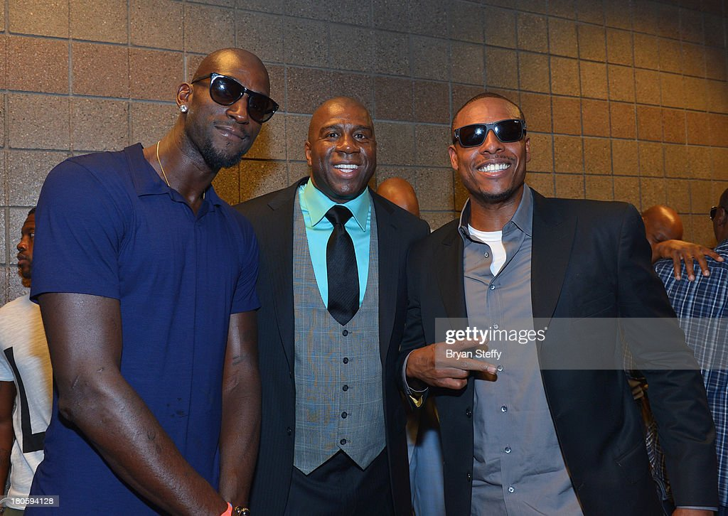 NBA player Kevin Garnett, NBA Hall of Fame member and Los Angeles Dodgers part owner Earvin 'Magic' Johnson and NBA player Paul Pierce appear at the MGM Grand Garden Arena for the Floyd Mayweather Jr. vs. Canelo Alvarez boxing match on September 14, 2013 in Las Vegas, Nevada.
