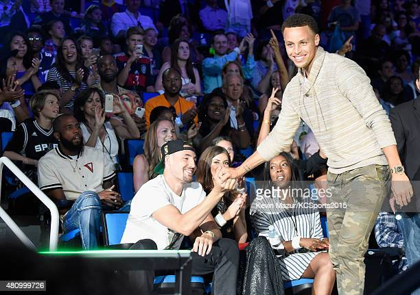 NBA player Klay Thompson greets NBA player Stephen Curry on his way to the stage to accept the Best Male Athlete Award at the Nickelodeon Kids'...