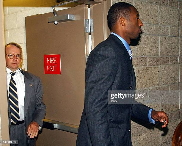 NBA player Kobe Bryant arrives at Eagle County Justice Center for the second day of jury selection as security agent Ed Killiam watches August 30...