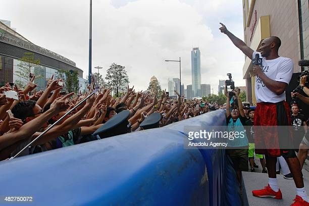 NBA player Kobe Bryant of the Los Angeles Lakers waves to fans during a promotional event at a store in Guangzhou city China's Guangdong province on...